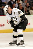 Sidney Crosby of the Pittsburgh Penguins watches a replay on the jumbotron during the third period of the game against the Washington Capitals on...