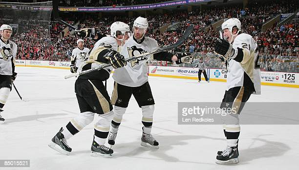 Sidney Crosby Pascal Dupuis and Ruslan Fedotenko of the Pittsburgh Penguins celebrate a second period goal against of the Philadelphia Flyers on...