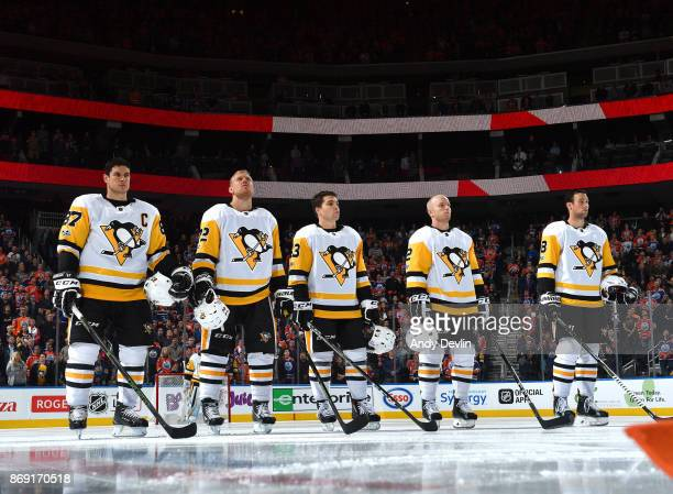 Sidney Crosby Patric Hornqvist Conor Sheary Chad Ruhwedel and Brian Dumoulin of the Pittsburgh Penguins stand for the singing of the national anthem...