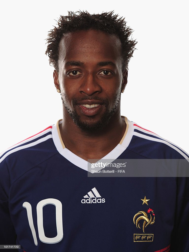 <a gi-track='captionPersonalityLinkClicked' href=/galleries/search?phrase=Sidney+Govou&family=editorial&specificpeople=242983 ng-click='$event.stopPropagation()'>Sidney Govou</a> of France poses during the official FIFA World Cup 2010 portrait session on June 7, 2010 in George, South Africa.