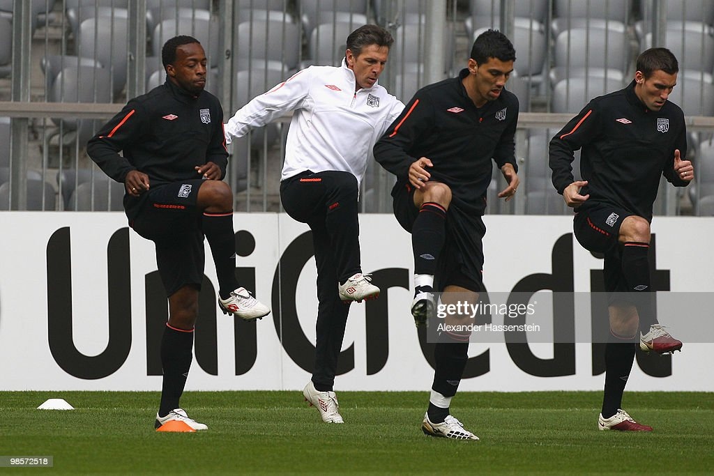 Sidney Govou (L) of Olympic Lyon runs with Claude Puel (2nd L) head coach of Lyon, Cleber Anderson (2nd R) and Anthony R?veill?re (R) during a training session at Allianz Arena on April 20, 2010 in Munich, Germany. Olympic Lyon will play against Bayern Muenchen at the UEFA Champions League semi final first leg match on April 21.