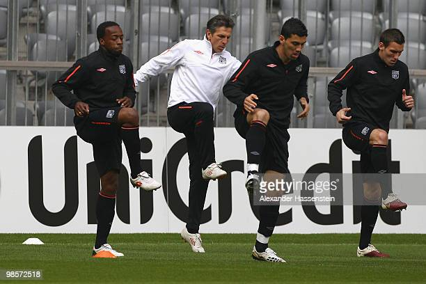 Sidney Govou of Olympic Lyon runs with Claude Puel head coach of Lyon Cleber Anderson and Anthony Rveillre during a training session at Allianz Arena...
