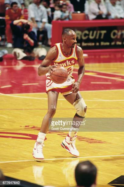 Sidney Moncrief of the Atlanta Hawks dribbles during a game played circa 1990 at the Omni in Atlanta Georgia NOTE TO USER User expressly acknowledges...
