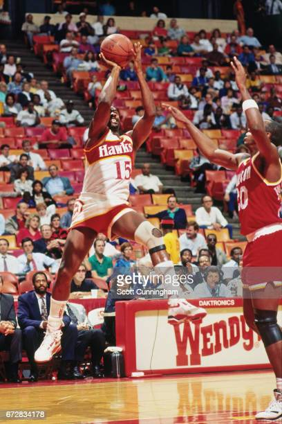 Sidney Moncrief of the Atlanta Hawks shoots against the Houston Rockets during a game played circa 1990 at the Omni in Atlanta Georgia NOTE TO USER...