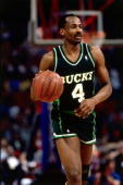 Sidney Moncrief of the Milwaukee Bucks dribbles upcourt in 1989 NOTE TO USER User expressly acknowledges and agrees that by downloading and or using...