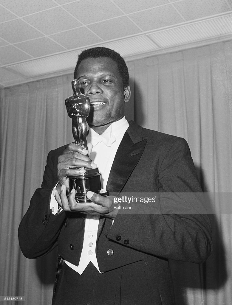 Sidney Poitier admires the Oscar he has just received in Santa Monica, California, on April 13, 1964. He won Best Performance by an Actor for his role in the 1963 film Lilies of the Field.