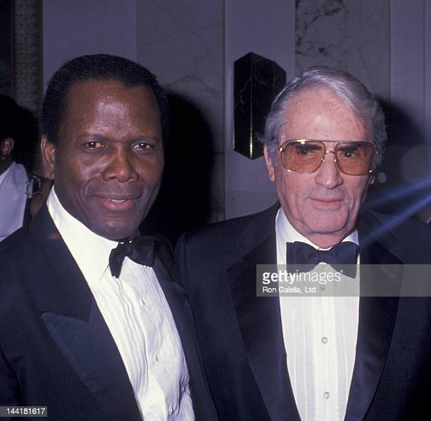 Sidney Poitier and Gregory Peck attend American Museum of the Moving Image Tribute Honoring Sidney Poitier on February 28 1989 at the Waldorf Hotel...