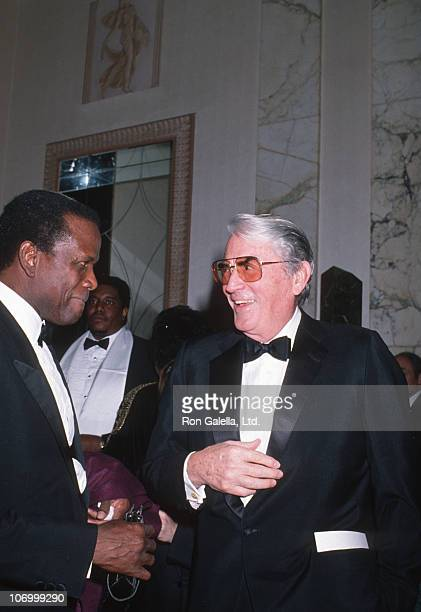 Sidney Poitier and Gregory Peck during The American Museum of the Moving Image Tribute to Sidney Poitier at Waldorf Hotel in New York City NY United...