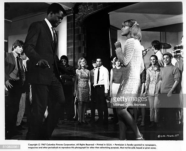 Sidney Poitier and Judy Geeson dance in a scene from the Columbia Pictures movie 'To Sir with Love' circa 1967