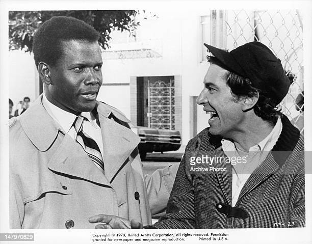 Sidney Poitier and Martin Landau enjoy a joke together in a scene from the film 'They Call Me MISTER Tibbs' 1970