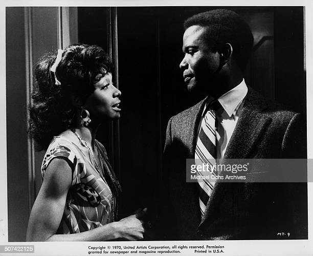Sidney Poitier Barbara McNair talk in a scene for the United Artist movie 'They Call Me Mister Tibbs' circa 1970