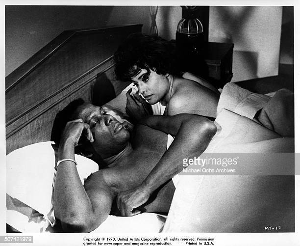 Sidney Poitier lies in bed with Barbara McNair in a scene for the United Artist movie 'They Call Me Mister Tibbs' circa 1970