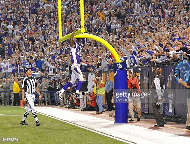 Sidney Rice of the Minnesota Vikings dunks the ball over the goalpost following a touchdown during an NFL game against the Cincinnati Bengals at the...