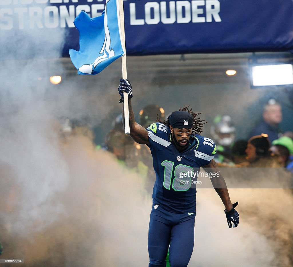 <a gi-track='captionPersonalityLinkClicked' href=/galleries/search?phrase=Sidney+Rice&family=editorial&specificpeople=793737 ng-click='$event.stopPropagation()'>Sidney Rice</a> #18 of the Seattle Seahawks is introduced against the St. Louis Rams at CenturyLink Field on December 30, 2012 in Seattle, Washington.