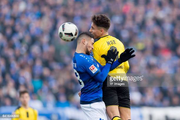 Sidney Sam of Darmstadt and Emre Mor of Dortmund battle for the ball during the Bundesliga match between SV Darmstadt 98 and Borussia Dortmund at...