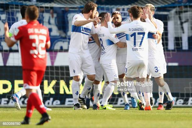 Sidney Sam of Darmstadt celebrates his team's second goal with team mates during the Bundesliga match between SV Darmstadt 98 and 1 FSV Mainz 05 at...