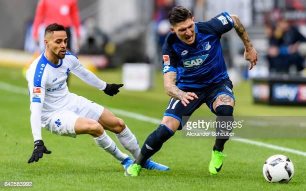 Sidney Sam of Darmstadt challenges Steven Zuber of Hoffenheim during the Bundesliga match between TSG 1899 Hoffenheim and SV Darmstadt 98 at Wirsol...