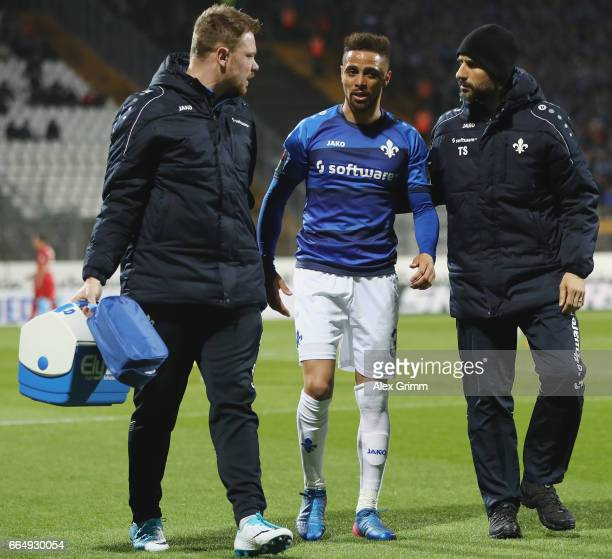 Sidney Sam of Darmstadt is led off the pitch during the Bundesliga match between SV Darmstadt 98 and Bayer 04 Leverkusen at Jonathan Heimes Stadion...