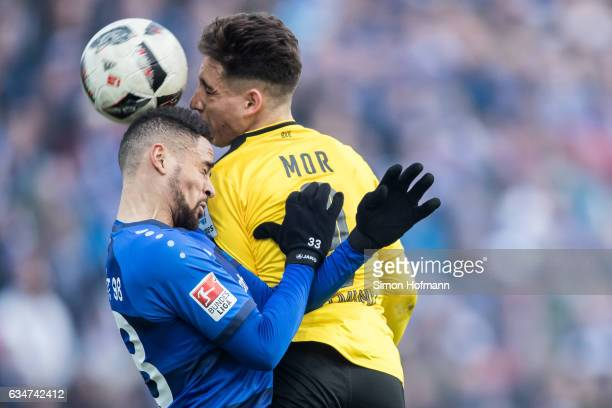 Sidney Sam of Darmstadt jumps for a header with Emre Mor of Dortmund during the Bundesliga match between SV Darmstadt 98 and Borussia Dortmund at...