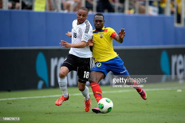 Sidney Sam of Germany and Walter Ayovi of Ecuador battle for the ball during the International Friendly match between Ecuador and Germany at FAU...