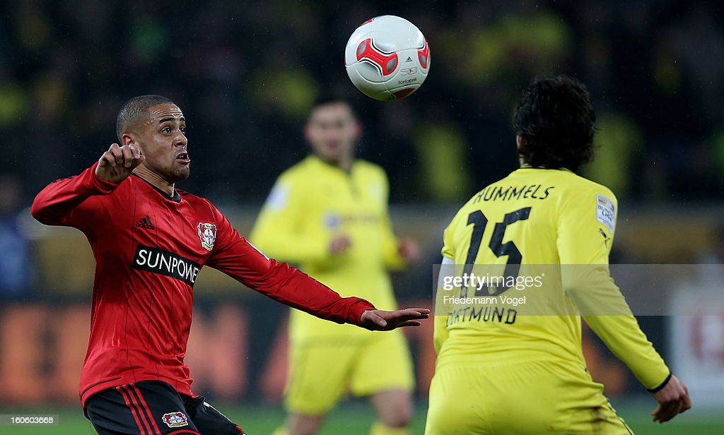 Sidney Sam of Leverkusen and Mats Julian Hummels of Dortmund battle for the ball during the Bundesliga match between Bayer 04 Leverkusen and Borussia Dortmund at BayArena on February 3, 2013 in Leverkusen, Germany.