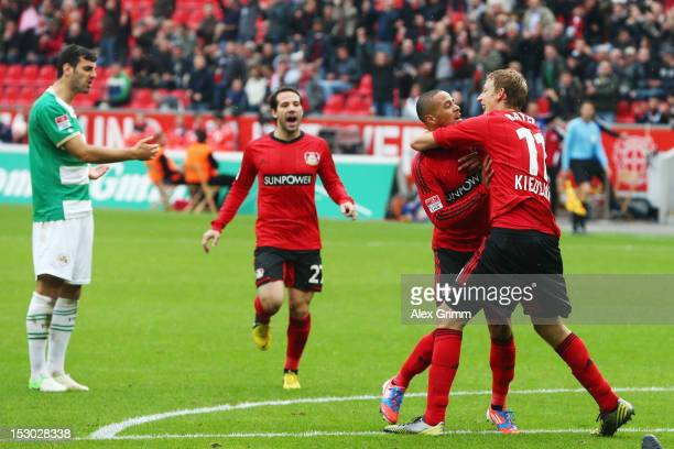 Sidney Sam of Leverkusen celebrates his team's first goal with team mates Stefan Kiessling and Gonzalo Castro during the Bundesliga match between...