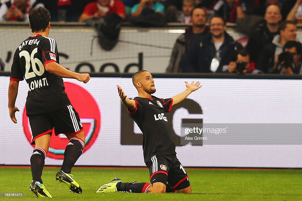 Sidney Sam (R) of Leverkusen celebrates his team's first goal with team mate Giulio Donati during the Bundesliga match between Bayer Leverkusen and FC Bayern Muenchen at BayArena on October 5, 2013 in Leverkusen, Germany.