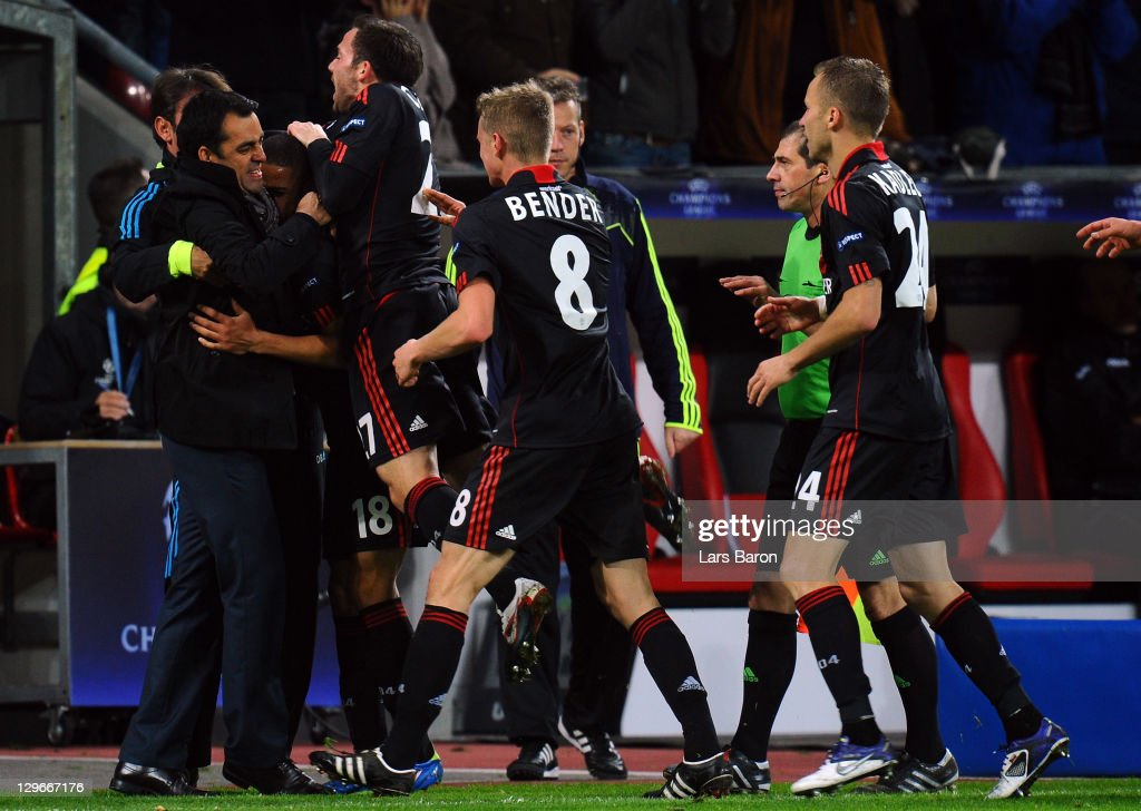 Sidney Sam of Leverkusen celebrates with head coach Robin Dutt after scoring his teams second goal during the UEFA Champions League group E match...