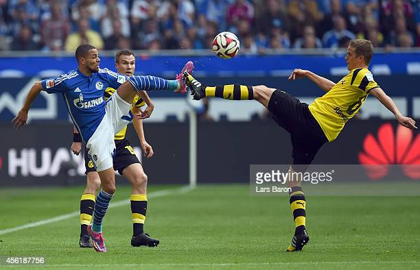 Sidney Sam of Schalke is challenged by Sven Bender of Dortmund during the Bundesliga match between FC Schalke 04 and Borussia Dortmund at Veltins...
