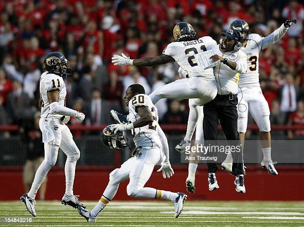 Sidney Saulter of the Kent State Golden Flashes celebrates a defensive stop with head coach Darrell Hazell against the Rutgers Scarlet Knights at...