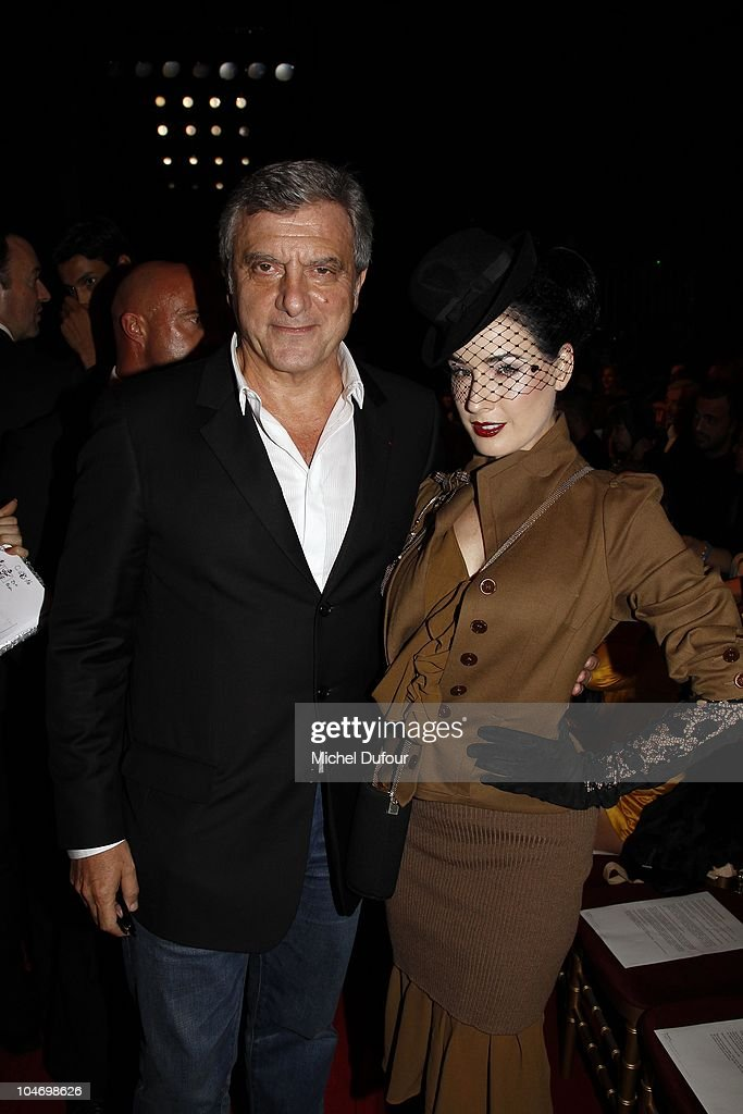 Sidney Toledano and Dita von Teese attend the John Galliano Ready to Wear Spring/Summer 2011 show during Paris Fashion Week at Opera Comique on October 3, 2010 in Paris, France.