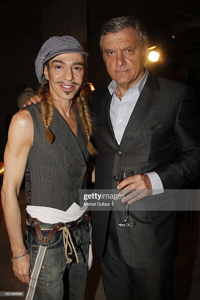 Sidney Toledano and John Galliano (L) pose prior to the John Galliano show as part of Paris Menswear Fashion Week Spring/Summer 2011 on June 25, 2010 in Paris, France.