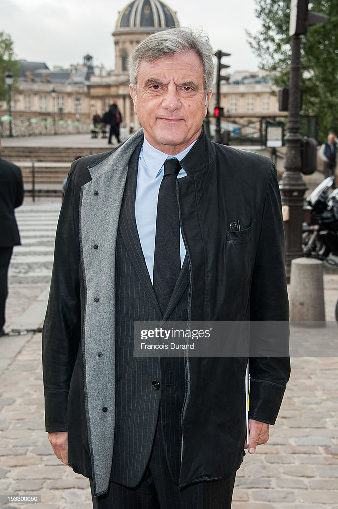 <a gi-track='captionPersonalityLinkClicked' href=/galleries/search?phrase=Sidney+Toledano&family=editorial&specificpeople=758670 ng-click='$event.stopPropagation()'>Sidney Toledano</a> arrives at the Louis Vuitton Spring/Summer 2013 show as part of Paris Fashion Week on October 3, 2012 in Paris, France.