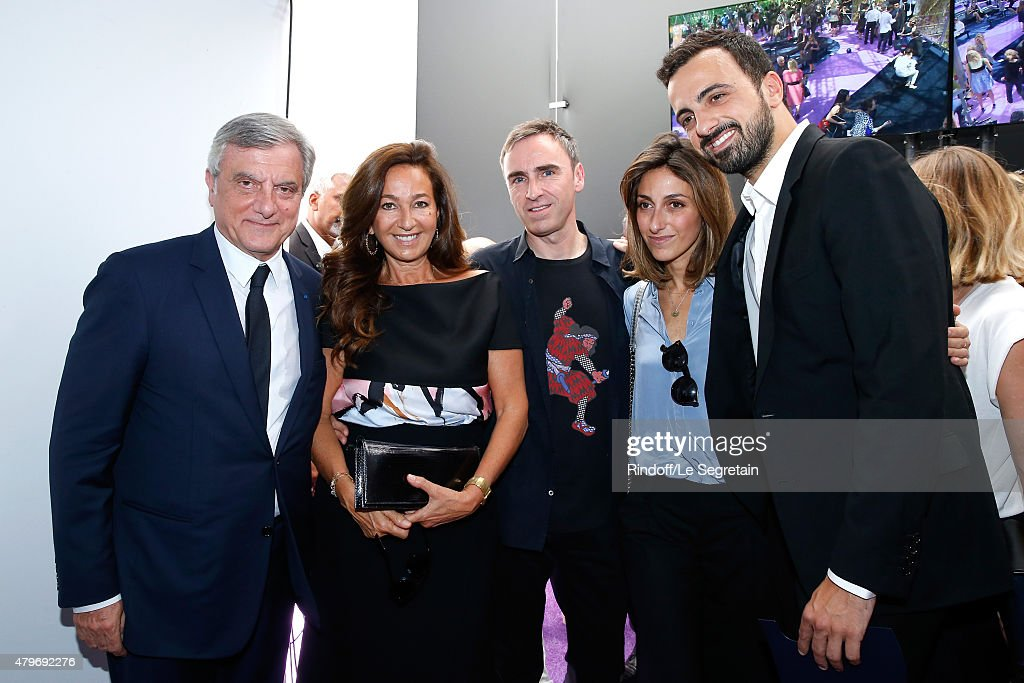 CEO DIOR, Sidney Toledano, his wife Katia Toledano, Fashion Designer Raf Simons, Children of Sidney Toledano, Julia Toledano and her brother Alan Toledano pose backstage after the Christian Dior show as part of Paris Fashion Week Haute-Couture Fall/Winter 2015/2016 on July 6, 2015 in Paris, France.