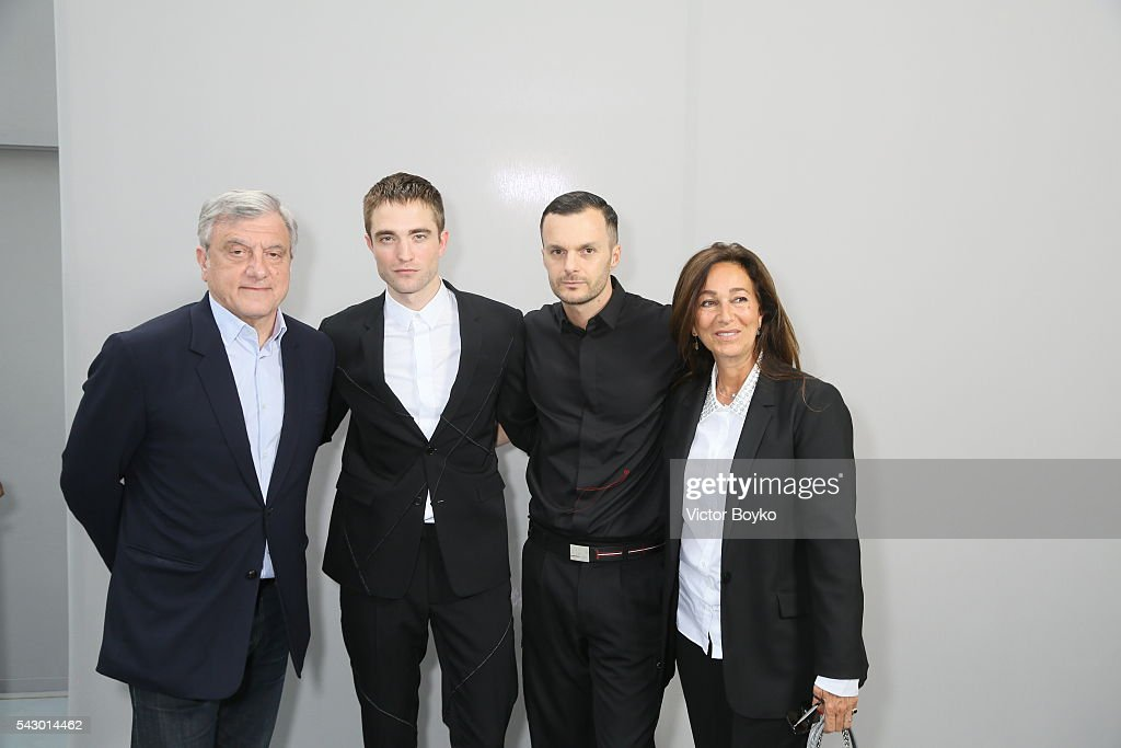 Sidney Toledano, Robert Pattinson, Kris Van Assche and Katia Toledano pose in the backstage before the Dior Homme Menswear Spring/Summer 2017 show as part of Paris Fashion Week on June 25, 2016 in Paris, France.