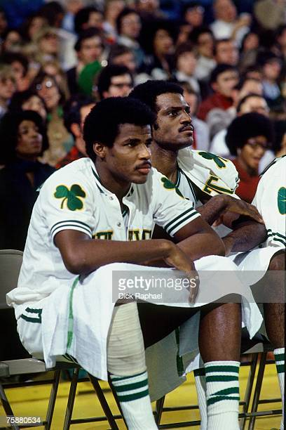 Sidney Wicks and Curtis Rowe of the Boston Celtics look on from the bench against the Houston Rockets during an NBA game circa 19761978 at the Boston...