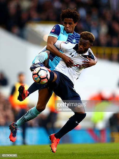 Sido Jombati of Wycombe Wanderers and GeorgesKevin Nkoudou of Tottenham Hotspur in action during the Emirates FA Cup Fourth Round match between...