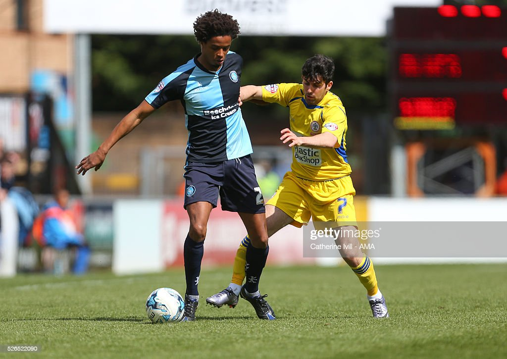 Sido Jombati of Wycombe Wanderers and Piero Mingoia of Accrington Stanley during the Sky Bet League Two match between Wycombe Wanderers and Accrington Stanley at Adams Park on April 30, 2016 in High Wycombe, England.