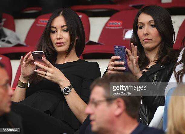 Sidonie Biemont girlfriend of Adil Rami of France and Jennifer Giroud wife of Olivier Giroud attend the international friendly match between France...