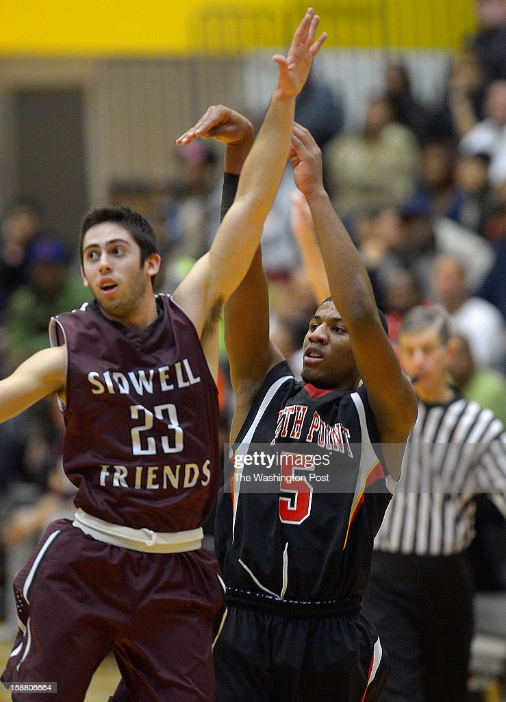 Sidwell defender Matt Hillman, left, watches North Point's Matt Bonds 3 pointer go in as North Point plays Sidwell Friends in the boy final of Waldorf Holiday Hoops Classic at North Point High School in Waldorf MD, December 28, 2012 .