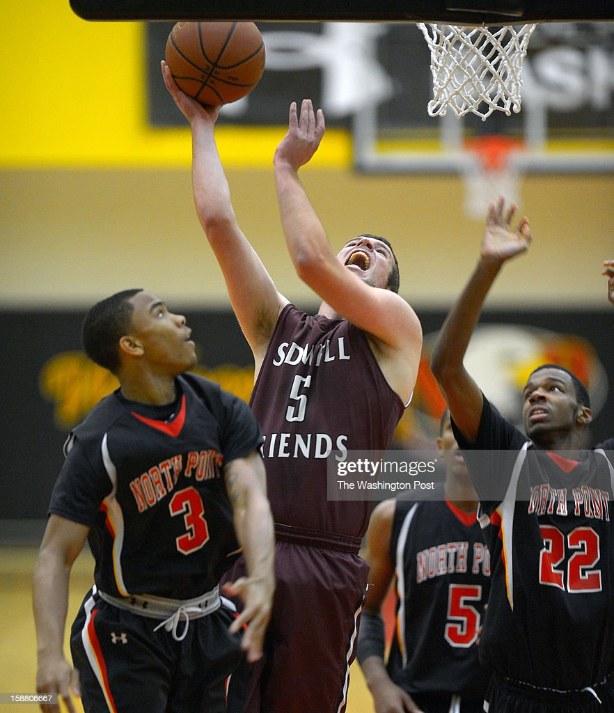 Sidwell's Aidan Monheim, center, shoots against North Point's Marquis Wright, left, and Daylin Davis, right, as North Point plays Sidwell Friends in the boy final of Waldorf Holiday Hoops Classic at North Point High School in Waldorf MD, December 28, 2012 .