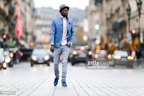 Sidya Sarr fashion and life style blogger @theparisian is wearing a Zara blue jacket a Zara hat an Andreas Osten watch Nike Cortez blue shoes Zara...