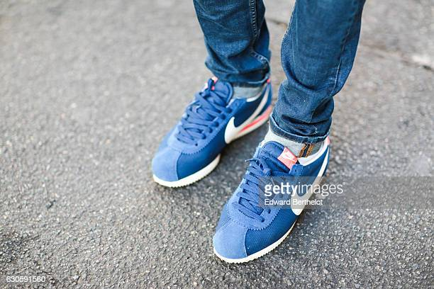 Sidya Sarr is wearing Nike Cortez blue shoes Asos blue denim jeans a Cafe Cotton white shirt an Andreas Osten watch green sunglasses and a Space...