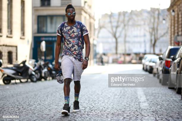 Sidya Sarr wears a Nixon cap hat a Torino Cortese watch Asos necklace and arm lace Ray Ban sunglasses Stance socks Nike Blazer shoes from Shinzo...