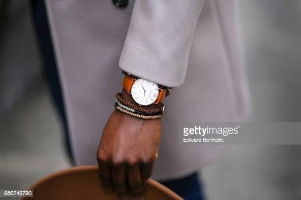 Sidya Sarr wears an Andreas Osten watch Asos arm jewelry Pull bear blue denim jeans pants Nike Blazer brown leather shoes from Shinzo Lab a Zara...