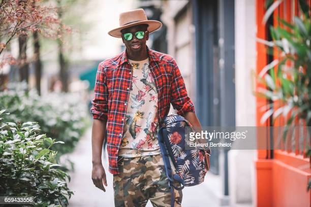 Sidya Sarr wears an Asos beige hat a Torino Cortese watch Asos necklace and armlace Hawkers green sunglasses Stance socks Nike Blazer sneakers shoes...
