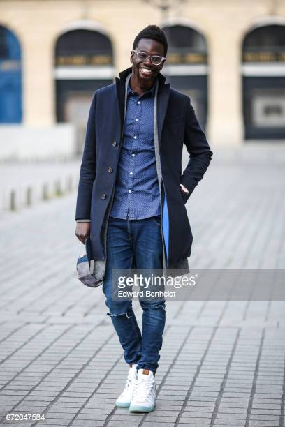 Sidya Sarr wears an Ice watch Asos jewelry an Asos shirt a Zara jacket a Bgarbo coat a Nixon cap hat Rayban glasses Kevin Durant Nike shoes from...