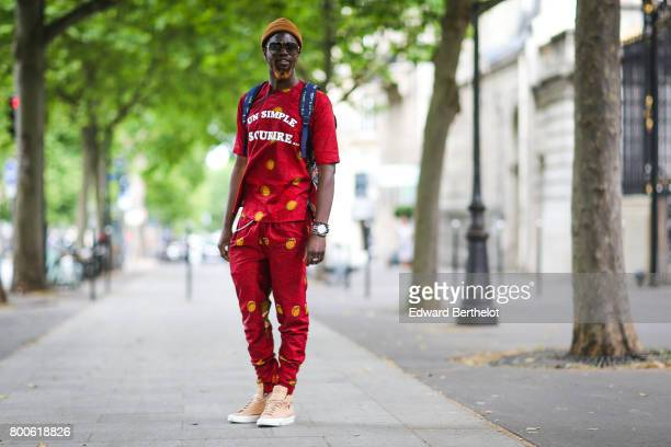 Sidya Sarr wears Nike shoes an Asos beanie hat an Andreas Osten watch pants and a tshirt 'un simple sourire' designed by himself during Paris Fashion...