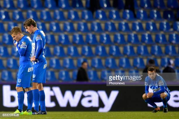 Siebe Schrijvers forward of KRC Genk Jere Uronen Juhani defender of KRC Genk and Boli Sander Berge midfielder of KRC Genk show dejection during the...