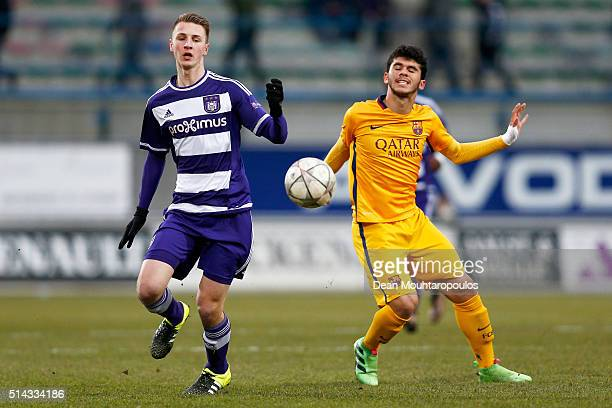 Siebe Van Der Heyden of Anderlecht battles for the ball with Carles Alena Castillo of Barcelona during the UEFA Youth League Quarterfinal match...